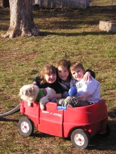 The kids and Gracie on a wagon ride